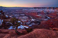 The sun rises over the canyons of Dead Horse Point State Park in Utah on a cold Winter morning.