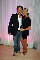 Actress TINA HOBLEY and her husband OLIVER WHEELER at the Lauren-Perrier 'Pop Art' Pink Party in aid of Capital 95.8's Help A London Child, held at Suka at the Sanderson Hotel, 50 Berners Street, London W1 on 25th April 2007.<br />