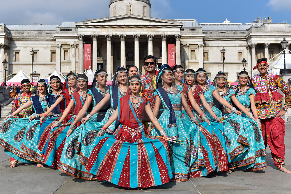 © Licensed to London News Pictures. 15/10/2017. London, UK. Traditional garba dancers line up at Diwali, the 'Festival of Lights', in Trafalgar Square.  Hosted by Sadiq Khan, Mayor of London, organisers present a variety of cultural activities and entertainment for visitors to enjoy.  Diwali is observed annually by Hindus, Sikhs and Jains in India and many other countries around the world.   Photo credit : Stephen Chung/LNP