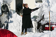 Christyann Mutka shovels snow off of her car in Alden, New York, USA on Wednesday, November 19, 2014. Up to six feet of snow fell on the region Tuesday, stranding dozens of motorists on roadways and causing at least six deaths.