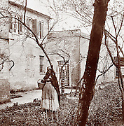 Alexandria, Virginia. Slave pen with black woman in foreground. Exterior view, circa 1863.