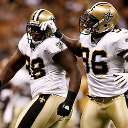 August 21, 2010; New Orleans, LA, USA; New Orleans Saints defensive tackle Sedrick Ellis (98) celebrates with teammate defensive end Alex Brown (96) following a sack during the first quarter of a preseason game at the Louisiana Superdome. Mandatory Credit: Derick E. Hingle