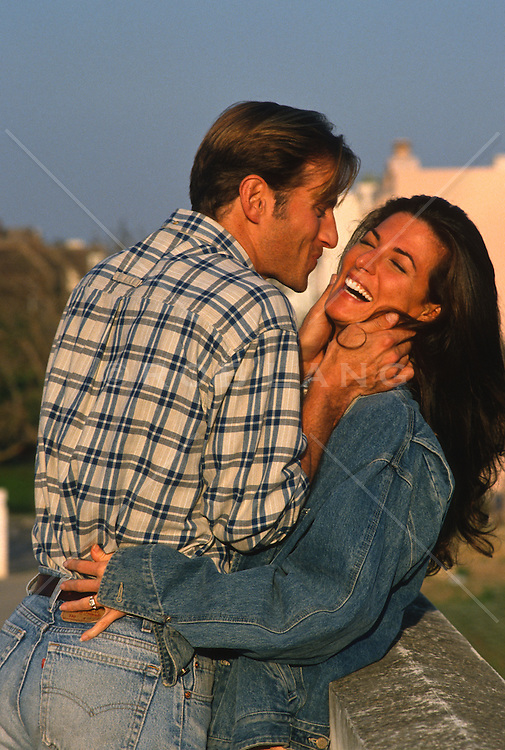 Man getting ready to kiss a happy Woman