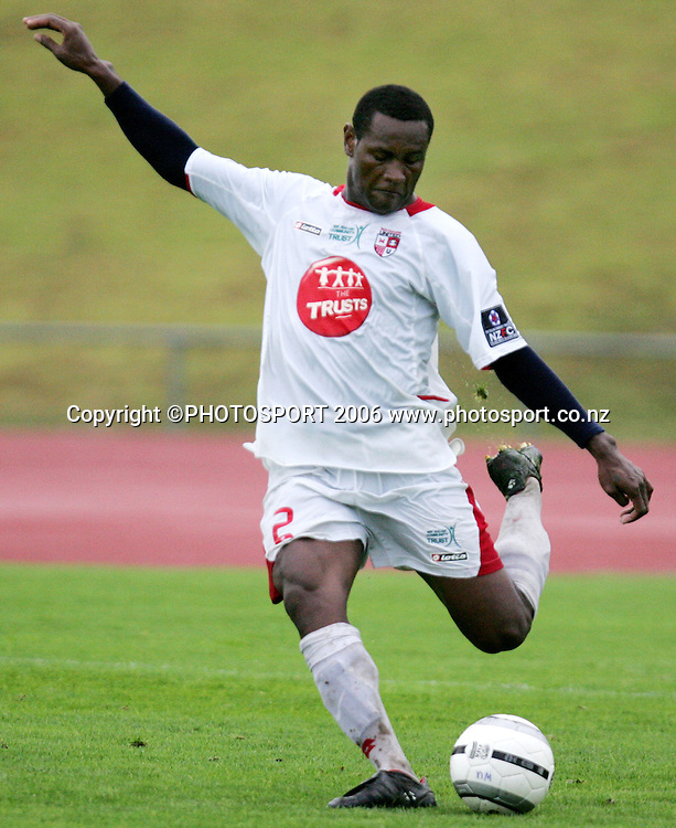 Waitakere United's George Suri kicks the ball up field during the NZFC Round 21 soccer match between Waitakere United and Auckland City at Trusts Stadium, Waitakere on Sunday 26 March 2006. Auckland City won the match 2-1. Photo: Tim Hales/PHOTOSPORT