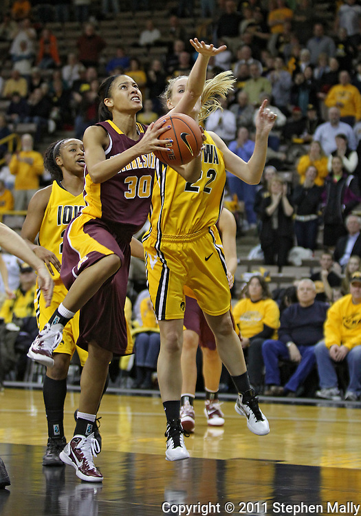 February 10 2011: Minnesota Golden Gophers guard Kiara Buford (30) looks to put up a shot around Iowa Hawkeyes forward Kelsey Cermak (22) during the second half of an NCAA women's college basketball game at Carver-Hawkeye Arena in Iowa City, Iowa on February 10, 2011. Iowa defeated Minnesota 64-62.