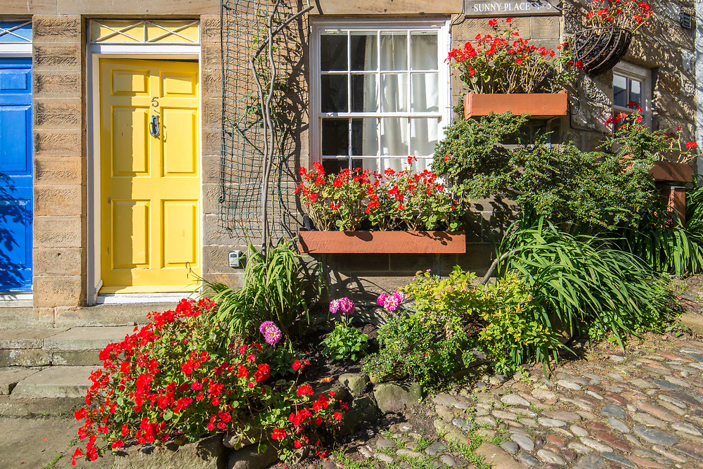 Welcoming yellow door,  Robin Hoods Bay, Yorkshire, UK