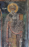 Fresco of a saint in the choir of the Dormition of Saint Mary Cathedral Church, or Kisha Katedrale Fjetja e Shen Marise, built 1699, Voskopoje, Korce, Albania. The church contains frescoes by Theodor Anagnost and Sterian from Agrapha in Greece, and the large icons in the iconostasis were painted 1703 by Constantine Lemoronachos. Picture by Manuel Cohen