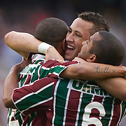 Mariano (left) celebrates with team mates, Diogo, (centre) and Julio Cesar (right) after scoring the first goal for Fluminense in their 3-0 win over Internacional during the  Futebol Brasileiro  Campeonato Brasileiro Serie-A 2010 League match at Maracana, the Jornalista Mário Filho Stadium, Rio de Janeiro,  Brazil. 15th August 2010. Photo Tim Clayton