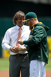 OAKLAND, CA - JUNE 21:  Former Oakland Athletics player Dennis Eckersley talks to Sean Doolittle #62 after throwing out the ceremonial first pitch before the game against the Boston Red Sox at O.co Coliseum on June 21, 2014 in Oakland, California. The Oakland Athletics defeated the Boston Red Sox 2-1 in 10 innings.  (Photo by Jason O. Watson/Getty Images) *** Local Caption *** Dennis Eckersley; Sean Doolittle