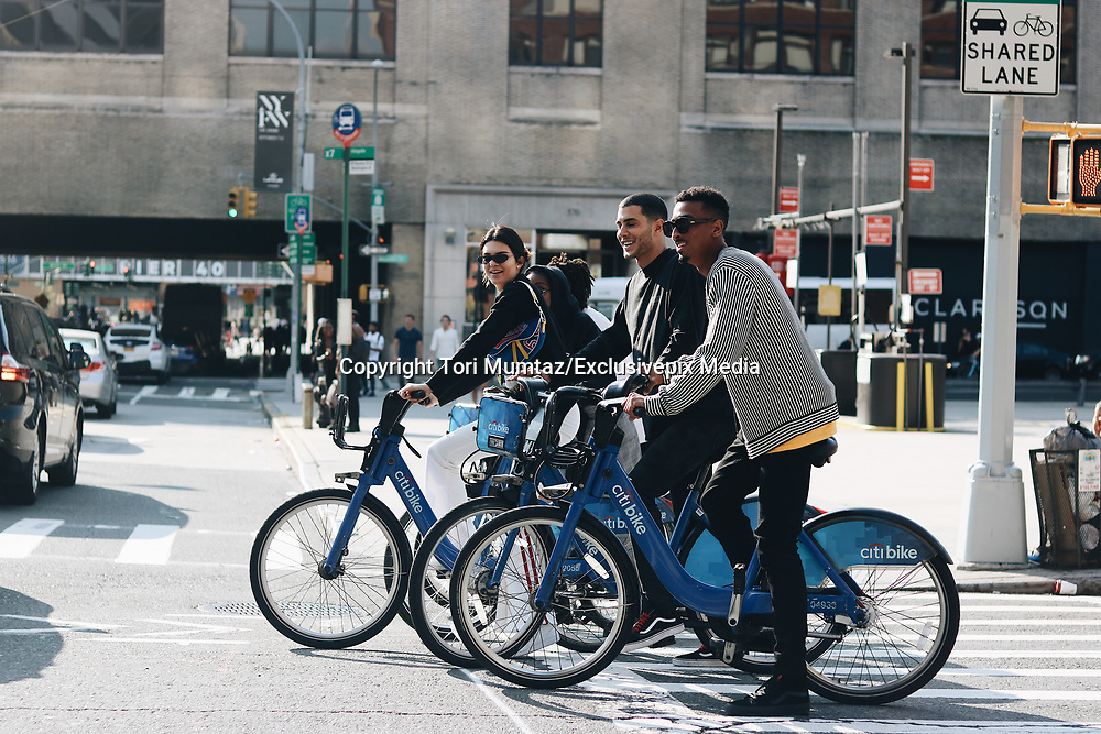 Kendall Jenner and her friends rode by the NYFW venue on CitiBikes, and stopped at a red light.<br /> &copy;Tori Mumtaz/Exclusivepix Media
