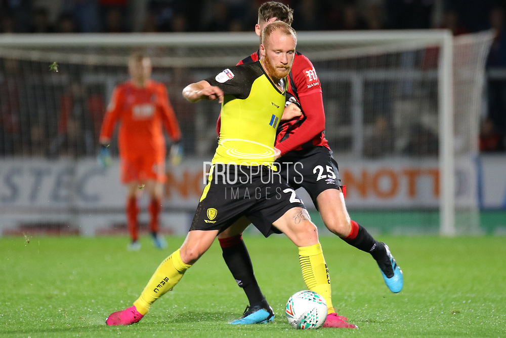Burton Albion forward Liam Boyce and Bournemouth defender Jack Simpson challenge for the ball during the EFL Cup match between Burton Albion and Bournemouth at the Pirelli Stadium, Burton upon Trent, England on 25 September 2019.
