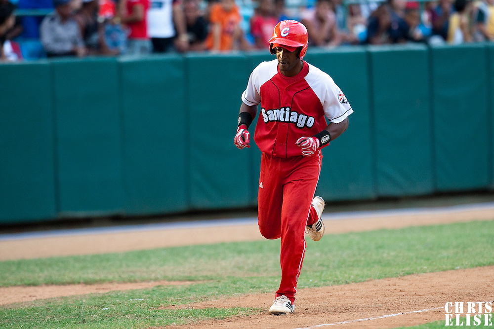 15 February 2009: Catcher Rolando Merino of the Orientales runs the bases after his homerun during a training game of Cuba Baseball Team for the World Baseball Classic 2009. The national team is pitted against itself, divided in two teams called the Occidentales and the Orientales. The Orientales win 12-8, at the Latinoamericano stadium, in la Habana, Cuba.