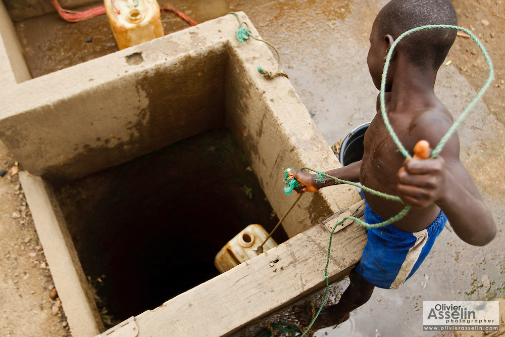 A boy draws water from a well in the village of Kawejah, Grand Cape Mount county, Liberia on Friday April 6, 2012.