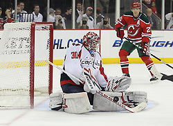 Mar 18; Newark, NJ, USA; Washington Capitals goalie Michal Neuvirth (30) makes a save while New Jersey Devils left wing Patrik Elias (26) during the second period at the Prudential Center.