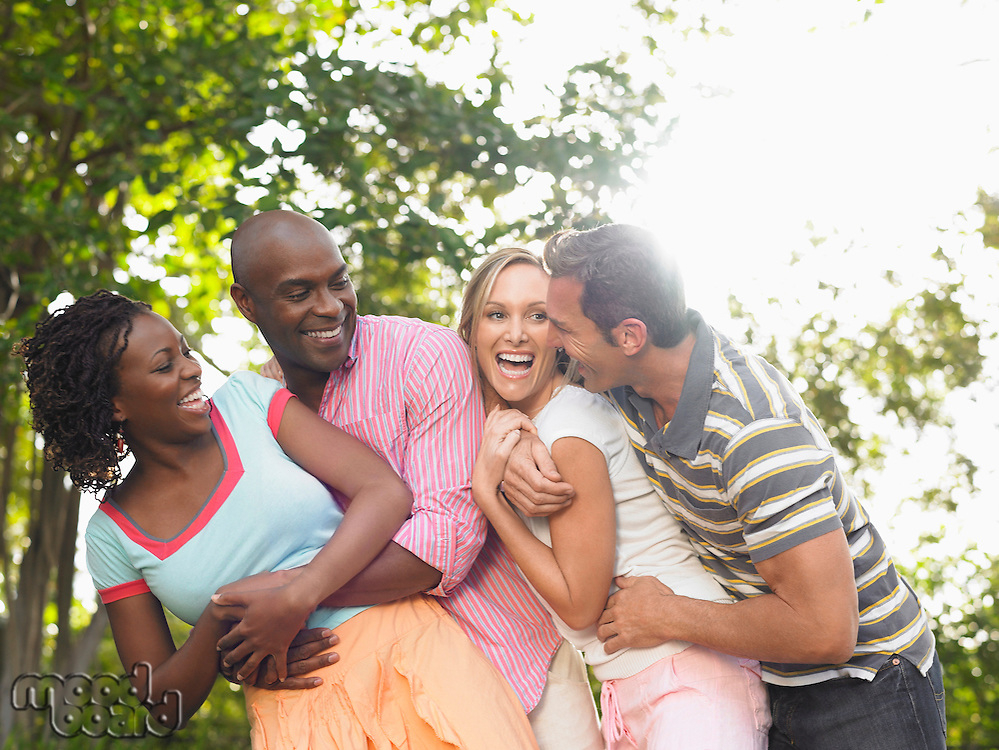 Two couples laughing in garden