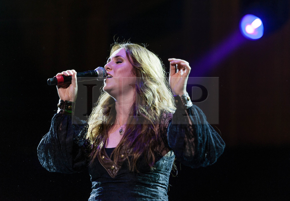 """© Licensed to London News Pictures. 16/09/2012. London, UK.  Sandi Thom performs at The Sunflower Jam at the Royal Albert Hall.  The Sunflower Jam is a British charity, founded by Jacky Paice, wife of Deep Purple drummer, Ian Paice. Other high-profile supporters are the actor Jeremy Irons, ex-Jamiroquai bassist Nick Fyffe and Charles, Prince of Wales. The aims of the charity are to fund complementary therapists and spiritual healers to work on cancer wards in the British National Health Service. After setting up a meeting between members of Deep Purple and a young boy dying of leukemia, Paice saw """"all the good work the healers were doing"""" and decided """"lets find a way to raise money to get more healers in there. Alexandria """"Sandi"""" Thom (born 11 August 1981, Banff, Aberdeenshire) is a Scottish singer-songwriter and multi-instrumentalist.  Photo credit : Richard Isaac/LNP"""