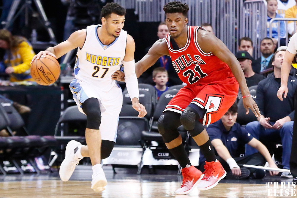 22 November 2016: Denver Nuggets guard Jamal Murray (27) drives past Chicago Bulls forward Jimmy Butler (21) during the Denver Nuggets 110-107 victory over the Chicago Bulls, at the Pepsi Center, Denver, Colorado, USA.
