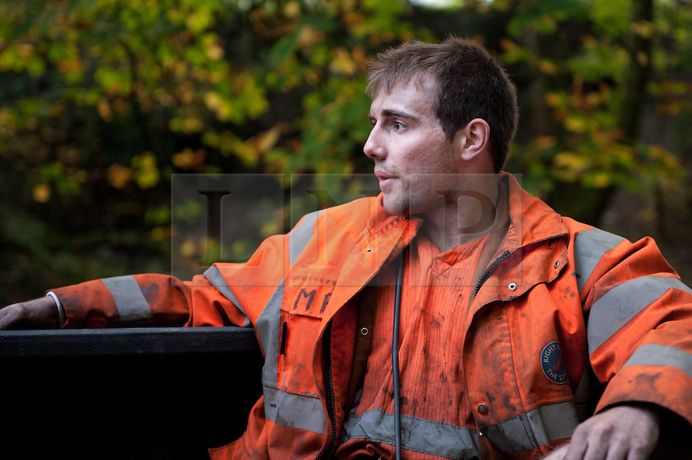© licensed to London News Pictures  16/09/2011 .  Pontardawe,UK. ..Picture: Miners travel to the face of the mine..News of a miner found dead at the mine is broken  as an operation continues to rescue  miners trapped in a mine in the Swansea Valley. Photo credit :Aled Llywelyn/LNP