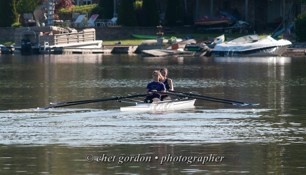 Two women complete their morning row on the East Arm of Greenwood Lake in Greenwood Lake, NY on Sunday morning, May 24, 2015.  #row #crew #rowing #lake #newyork #ny #greenwoodlake #photojournalism #nikonD300 #raw #300mm