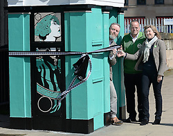 Scottish Green party candidates for the Lothians Alison Johnstone (right) and Andy Wightman (centre) officially unveil the latest piece of art by Leith-based artist Stewart Bremner (left), a specially-designed and painted decommissioned police box on Leith Walk, Edinburgh.<br /> <br /> <br /> &copy; Dave Johnston/ EEm