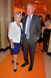 JUDITH CHALMERS and NEIL DURDEN-SMITH at the Veuve Clicquot Business Woman Awards held at Claridge's, Brook Street, London on 11th May 2015.