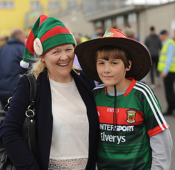 Edel Cassidy from Claremorris and her nephew Cillian on their way to watch Mayo v Derry.<br />Pic Conor McKeown
