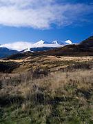 The Puketeraki Range rises above a brown grass paddock; New Zealand; June 2013