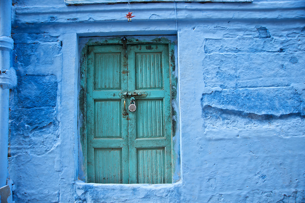 """Johpur is known as """"The Blue City"""" due to the Brahman neighborhoods being painted in blue.  The blue is an historic color for Brahman homes that most of the city adopted.  It is said to keep the mosquitoes at bay and the temperatures cooler.  The peppers above the door are for good fortune and protection from evil."""