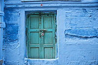 "Johpur is known as ""The Blue City"" due to the Brahman neighborhoods being painted in blue.  The blue is an historic color for Brahman homes that most of the city adopted.  It is said to keep the mosquitoes at bay and the temperatures cooler.  The peppers above the door are for good fortune and protection from evil."