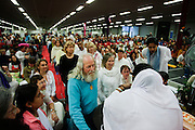 Mensen wachten op hun beurt voor de darshan, oftewel omhelsing door Amma. In de Expo in Houten is Mata Amritanandamayi, beter bekend als Amma of 'hugging mother', aanwezig om mensen te omhelzen en te inspireren. Het driedaags benefiet in Houten is het grootste spirituele festival in Nederland en zal naar verwachting 15.000 bezoekers trekken.<br /> <br /> A visitor is receiving the darshan from Amma. In the Expo in Houten people are gathering to get a darshan, or hug, by  Mata Amritanandamayi, also known as Amma or 'hugging mother'. Amma is travelling through the world to hug people for inspiring them to make a better world. Amma is one of the twelve most influence spiritual leaders of the world. The event in Houten lasts for three days and is the biggest spiritual event of The Netherlands.