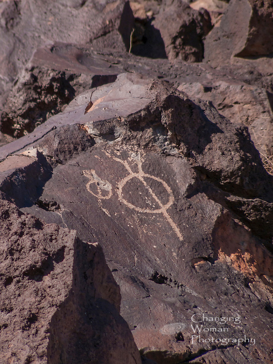 "This petroglyph of a circle bisected by a straight line is a classic example of the ""water glyph"" identified by Bob Ford and Dixon Spendlove in their explorations of Anasazi petroglyphs in southern Utah, northern Arizona, and southeastern Nevada. Ford and Spendlove have discovered that such symbols point to and mark water sources.  Did this glyph from Petroglyphs National Monument convey the proximity of the river we know as Rio Grande?"