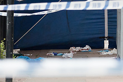 © Licensed to London News Pictures. 02/06/2018. London, UK.  Blood stained items inside th police forensic tent at the crime scene cordon in Cable Street, east London this morning. Police were called to Cable Street E1 at 17:56 on Friday 1st June to reports of a stabbing. A 22 year old male suffering from multiple stab wounds was taken to an east London hospital in a critical condition. The victim remains in a critical condition this morning.  Photo credit: Vickie Flores/LNP