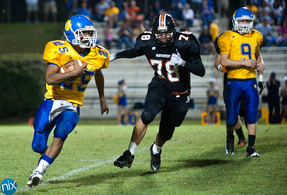 Mount Pleasant's Junior Gonzales carries the ball against Northwest Cabarrus Friday night at Northwest Cabarrus High School. (Photo by James Nix)
