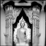 A Buddha decorates a temple in Chaing Mai, Thailand.