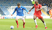 Conor Chaplin and Stephane Zubar battling for posession during the Sky Bet League 2 match between Portsmouth and York City at Fratton Park, Portsmouth, England on 2 May 2015. Photo by Michael Hulf.