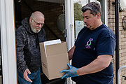 MERTHYR TYDFIL, WALES - 05 MAY 2020: The Stephens and George Centenary Charitable Trust prepare & deliver food bank parcels to vulnerable people who are self isolating during the covid19 lockdown.