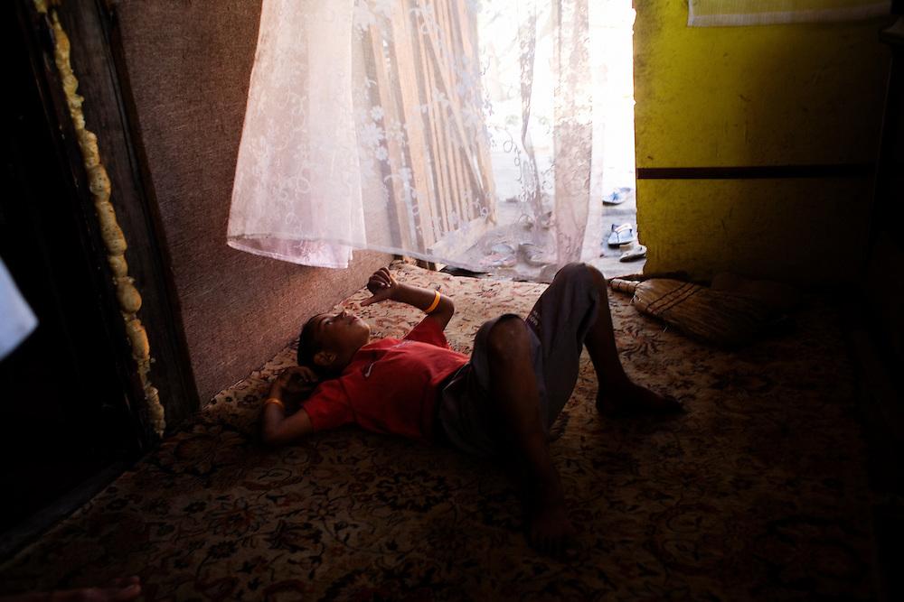 A young boy in the entrance to a home in Nova Gazela.