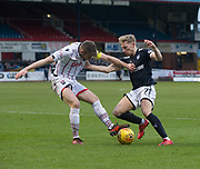 3rd February 2018, Dens Park, Dundee, Scotland; Scottish Premier League football, Dundee versus Ross County; A-Jay Leitch-Smith of Dundee runs at Jason Naismith of Ross County