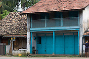 An old house on the Galle Road. A classic shop house. Most of the old facades have now been destroyed with road widening over the years.