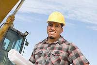 Construction worker holding blueprints, portrait
