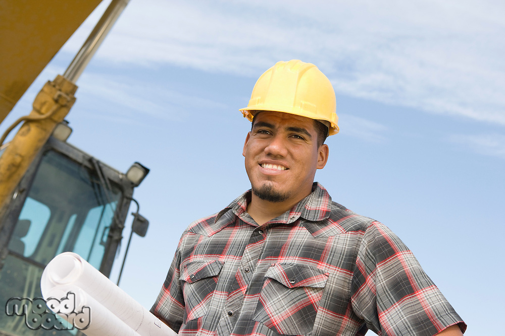 Construction worker holding blueprints, portrait