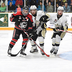 TRENTON, ON - Apr 18, 2016 -  Ontario Junior Hockey League game action between the against the Trenton Golden Hawks and the Georgetown Raiders. Game 3 of the Buckland Cup Championship Series, at the Duncan Memorial Gardens in Trenton, Ontario. Andrew Court #88 of the Georgetown Raiders battles for control with Josh Allan #53 and Chays Ruddy #4 of the Trenton Golden Hawks during the first period.<br /> (Photo by Andy Corneau / OJHL Images)