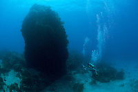 "Divers navigate ""Thumb Rock""..Shot in British Virgin Islands"