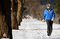 "JEROME A. POLLOS/Press..Pat Keilig walks along the Centennial Trail Monday when the temperature was hovering around 20 degrees. ""It's a beautiful day to be outside,"" Keilig said. ""The sun makes it feel much warmer than it is."""