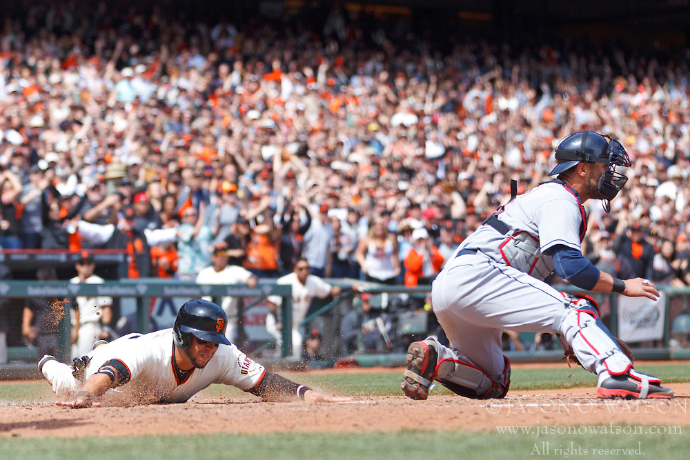 SAN FRANCISCO, CA - APRIL 26:  Gregor Blanco #7 of the San Francisco Giants scores a run past Yan Gomes #10 of the Cleveland Indians during the fifth inning at AT&T Park on April 26, 2014 in San Francisco, California. (Photo by Jason O. Watson/Getty Images) *** Local Caption *** Gregor Blanco; Yan Gomes