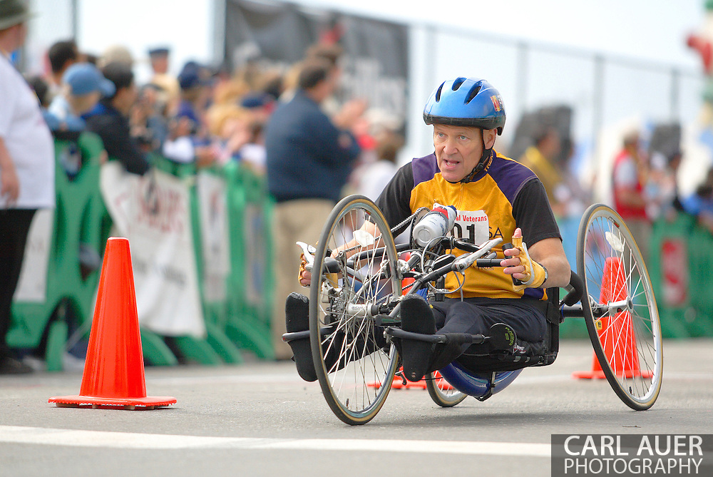 July 4th, 2006:  Anchorage, Alaska - David Nau (201), a Army veteran from Perry, Ohio, crosses the finish line in the 5k Handcycle Race at the 26th National Veterans Wheelchair Games.
