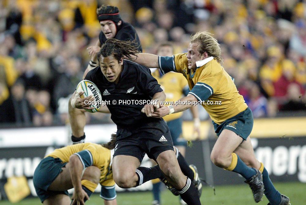 26th July, 2003. Telstra Stadium, Sydney, Australia. Bledisloe Cup. All Blacks v Wallabies. <br />Tana Umaga<br />The All Blacks won the match, 50 -21.<br />Pic: Andrew Cornaga/Photosport