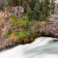 The flow of the Yellowstone River is fast! As seen from the Brink of the Upper Falls platform. Yellowstone National Park, Wyoming.