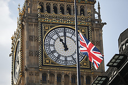 May 25, 2017 - London, United Kingdom - Big Ben clock strikes 11am as one minute silence is observed for the victims of the Manchester Arena bombing, outside New Scotland Yard in Westminster, London. (Credit Image: © Tolga Akmen/London News Pictures via ZUMA Wire)