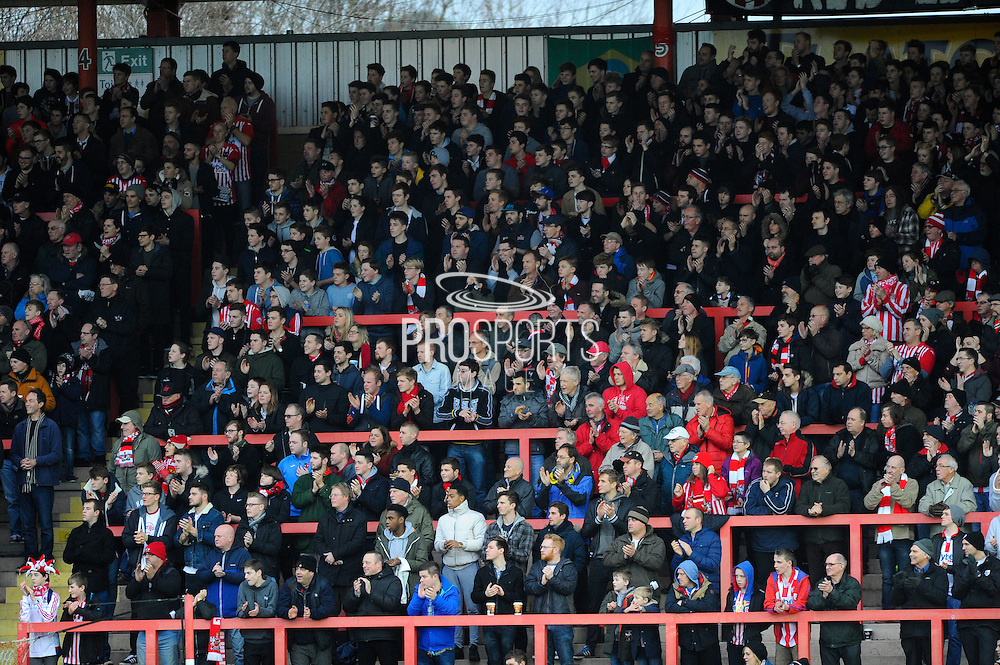 Fans give a miniutes applause in memory of Exeter supporter David Hunt during the Sky Bet League 2 match between Exeter City and Accrington Stanley at St James' Park, Exeter, England on 23 January 2016. Photo by Graham Hunt.